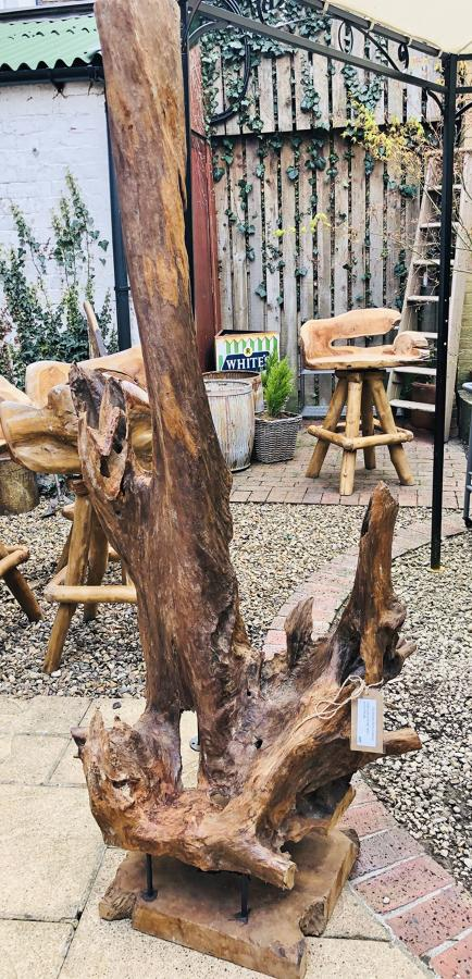 Teak tree sculpture