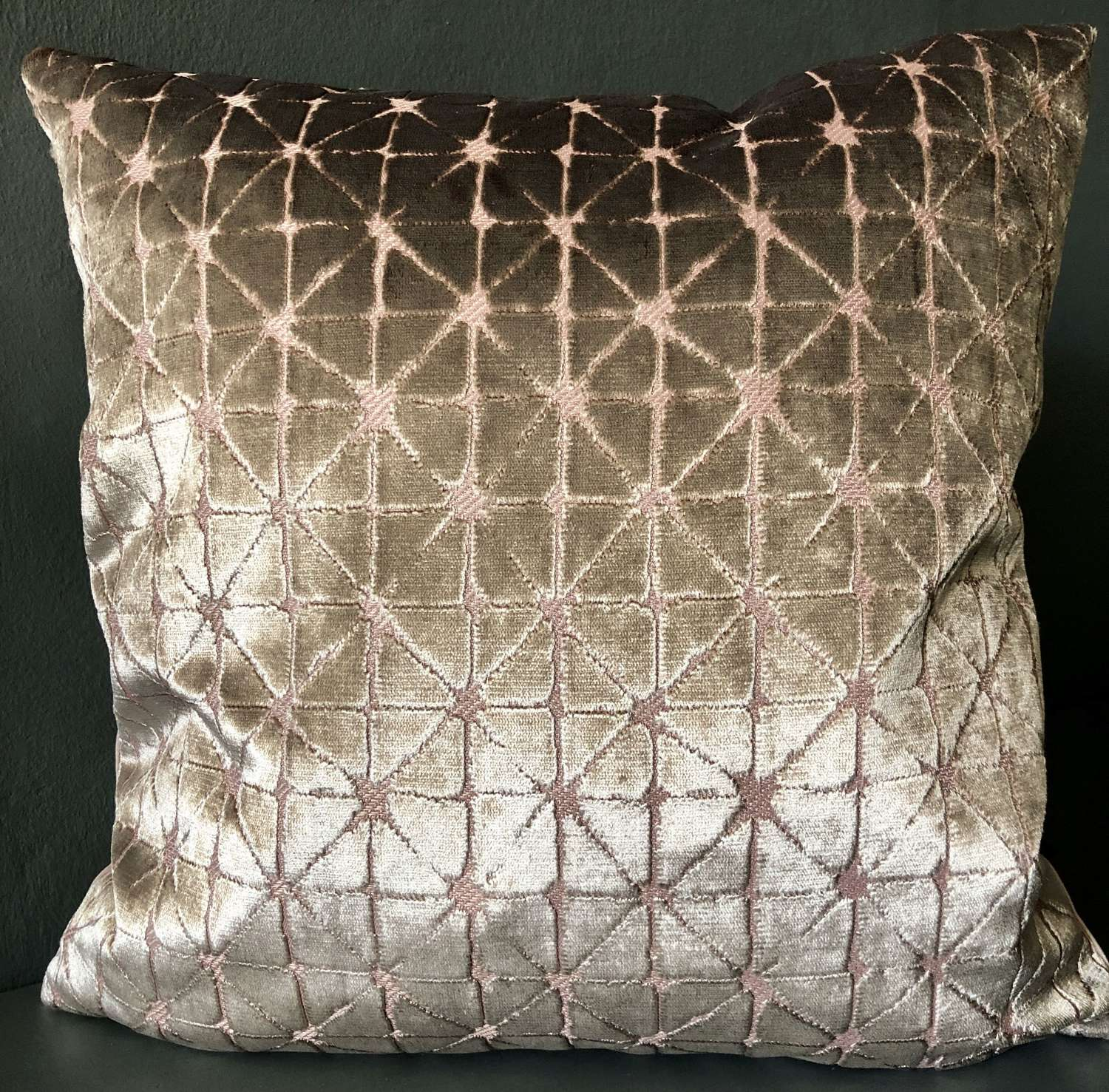 Pink and gold geometric cushion