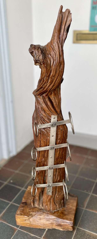 Teak sculpture wine rack