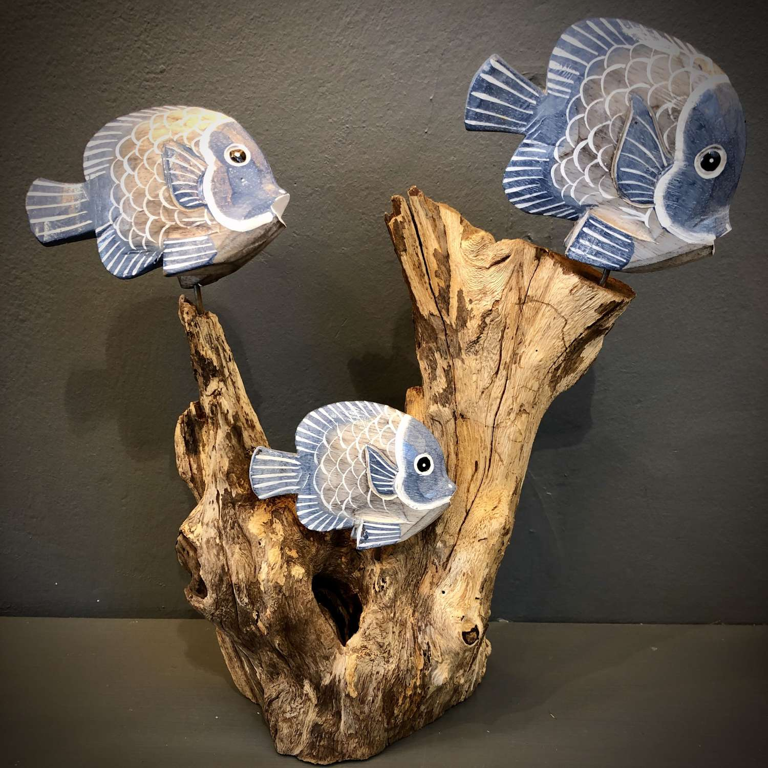 Carved fish on a wooden reef
